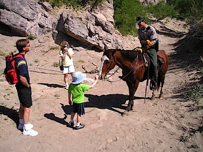 NPS ranger talks with park visitors